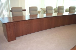 U-shaped conference table features radial grain Macore top with a beveled cherry edge detail